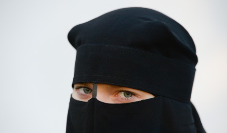 Bank ejects Muslim woman over full-face veil