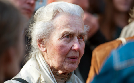 'Nazi Grandma' escorted from SS trial after being attacked