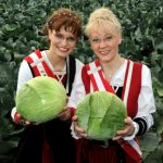 Another favourite German food, the cabbage, naturally has its own queen. This is Sonja I. (l) und Britt I., proud cabbage queens of Schleswig-Holstein in 2010.Photo: Photo: DPA