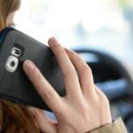 'I only scratched my head with phone' driver convinces court