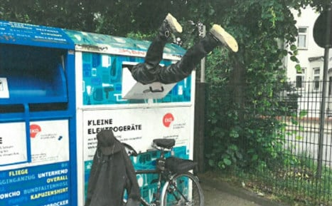 Puzzled cops pull pair of legs out of bin for second time