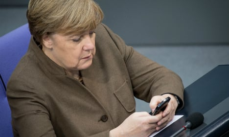 Russia blamed for hacking attacks on Merkel and MPs