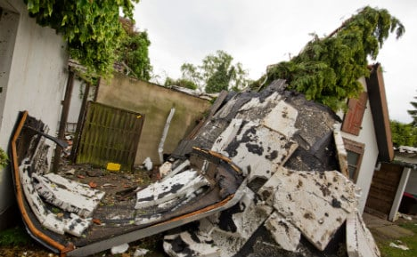 Tornado rips off roofs as storm batters west Germany