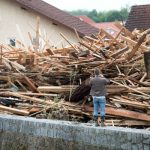A resident of Simbach am Inn, Bavaria, photographs a pile of wood dumped by the flooding.Photo: DPA