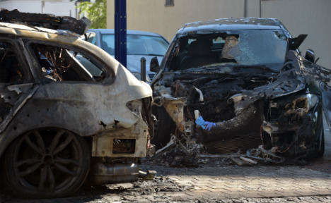 Left-wing extremists attack banks, burn cars in Berlin
