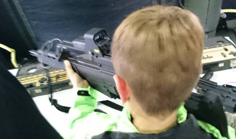 Shock as German soldiers let kids play with machine guns