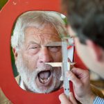Uwe Lenz trying his best to make his nose the biggest in the competition.Photo: Photo: DPA