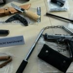 Huge weapons cache found at home of hate speech suspect