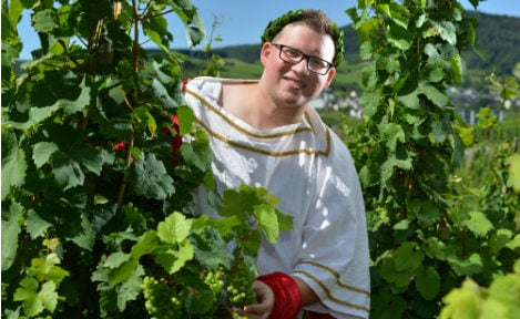 Man becomes wine queen after no blond beauties found