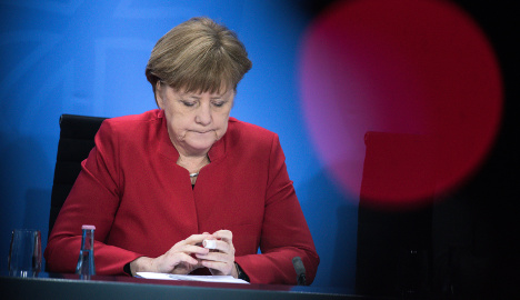 Merkel's approval rating sinks to five-year low