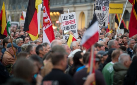 Pegida take to Dresden streets – to march against Pegida