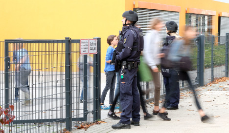 Police search 12 German schools after email threats