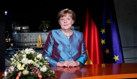 Merkel urges Germans to meet terror with freedom and openness
