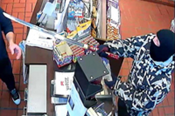 VIDEO: Police search for thief who robbed petrol station with 'samurai sword'