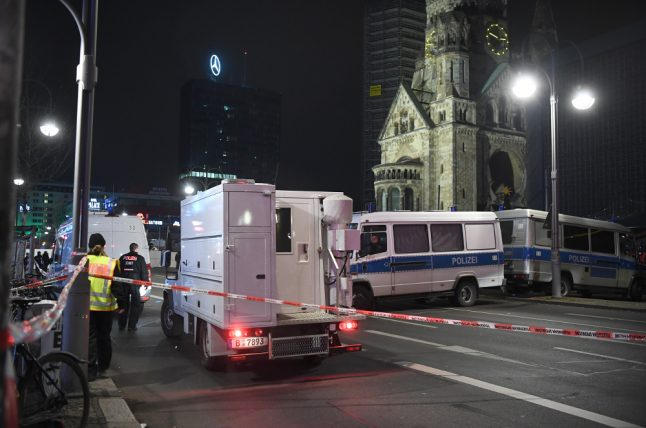 Police raid potential 'contacts' of Christmas market attacker