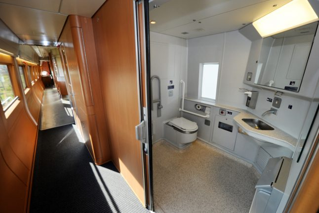 Fare-dodger caught grooming 'intimate parts' inside train loo