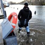 A man wades through water at the bank of the River Trave in Lübeck on Thursday.Photo: DPA