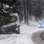 The road conditions were too slippery for this truck driver, as police cordon off the road by the crash in Bavaria.Photo: DPA