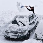 This man is seen digging out his car by hand, having been submerged by snow in Hesse.Photo: DPA