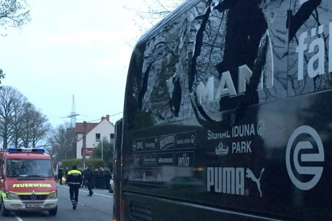Police search for clues after explosions near Dortmund team bus injure player