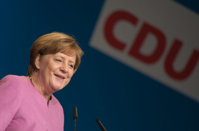 Strong win in state poll boosts Merkel's party ahead of national vote