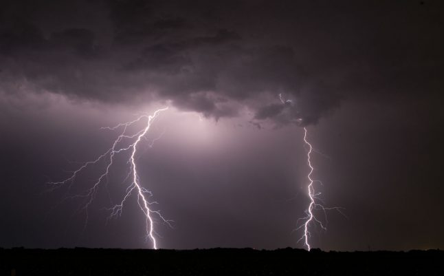 Woman killed by lightning strike while cycling in west Germany