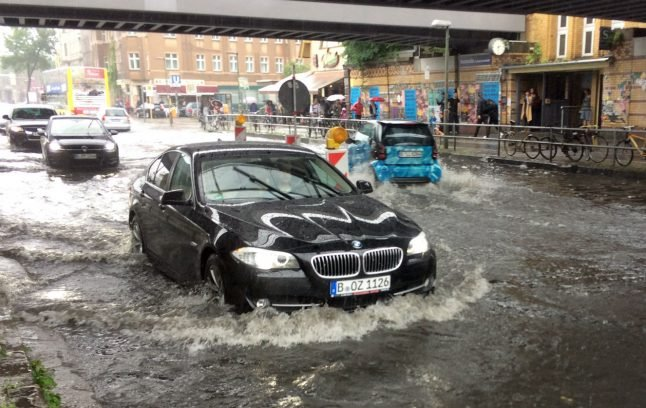 Torrential rain swamps Berlin's streets, stretches firefighters to limits