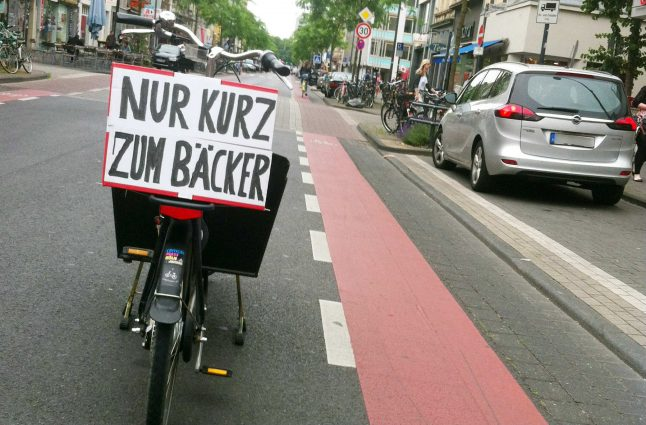 Cyclist blocks street to 'pop into bakery' and becomes internet hit