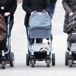 Fight among mothers over baby buggies leaves three police officers injured