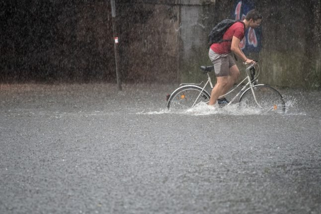 Heavy storms flood streets, kill one in west Germany
