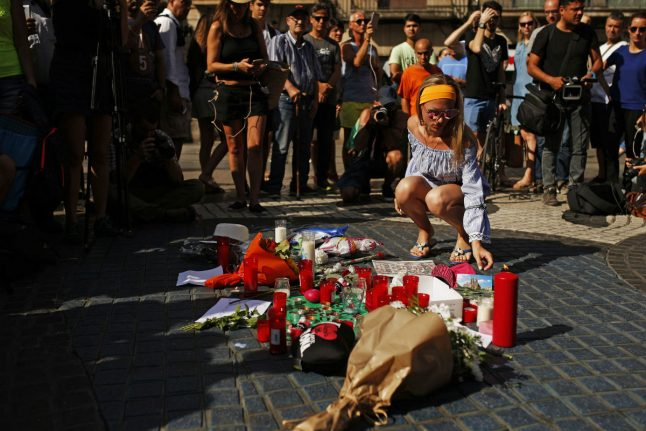 Merkel: We won't halt election rallies but we will mourn Spain attack victims