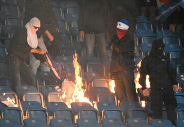 Renewed football violence as fans burn seats and banner at Berlin cup match