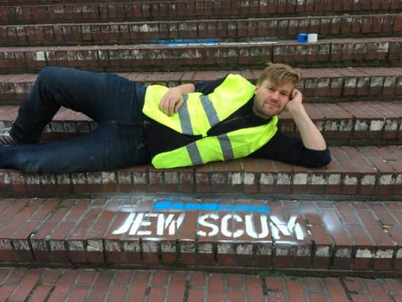Twitter wouldn't delete hateful tweets so this artist painted them outside its office