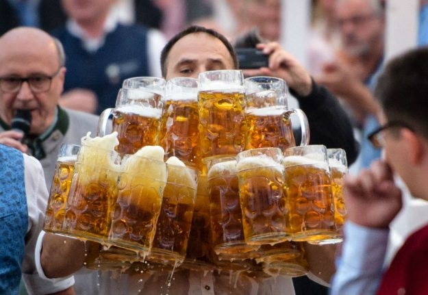 Bavarian smashes world record by carrying 70kg of beer at historic festival