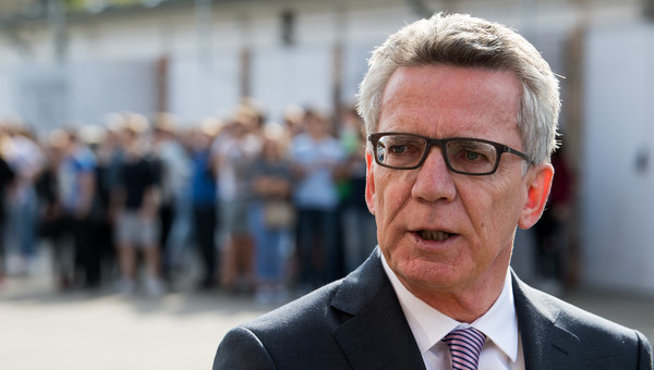German aid to migrants creating 'pull effect': minister