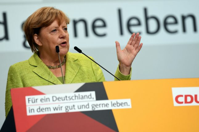 Merkel calls out haters, as boos and whistles greet her once again on campaign trail