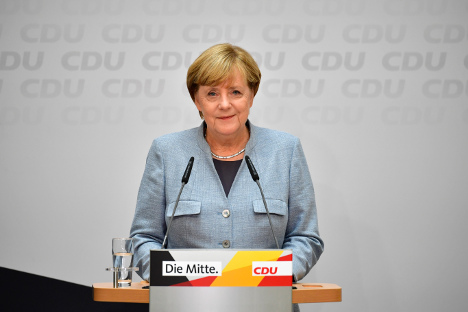 Merkel confirms ready to govern with liberals and Greens