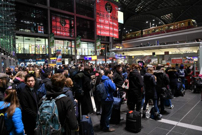 Queues snake through Berlin central station as train standstill continues