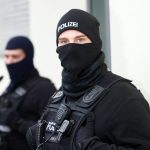 Alleged Islamist arrested as police seize large arms stock in Berlin raids