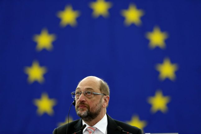 Schulz says EU allies urged him to join Merkel government and push for reforms
