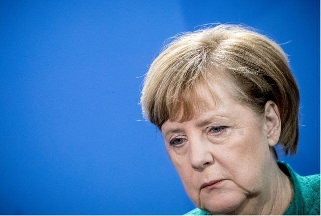 Merkel calls for end to talks on new government as power ebbs away