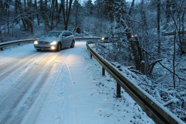 Police call drivers to caution as thick snow falls in western Germany