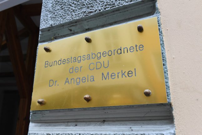 Far-right group protests with funeral candles at Merkel's office after Freiburg murder verdict