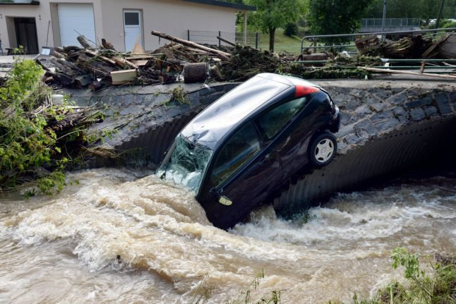 'Tropical' heat predicted after storms bring floods and mudslides