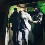 Police raid migrant smuggling network with connections to far-right
