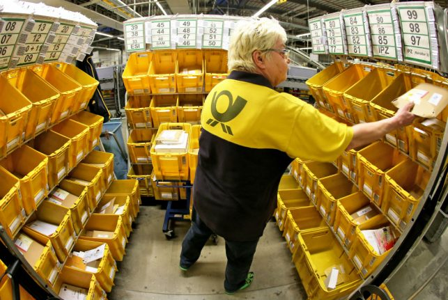 Deutsche Post under fire for penalizing employees who call in sick too often
