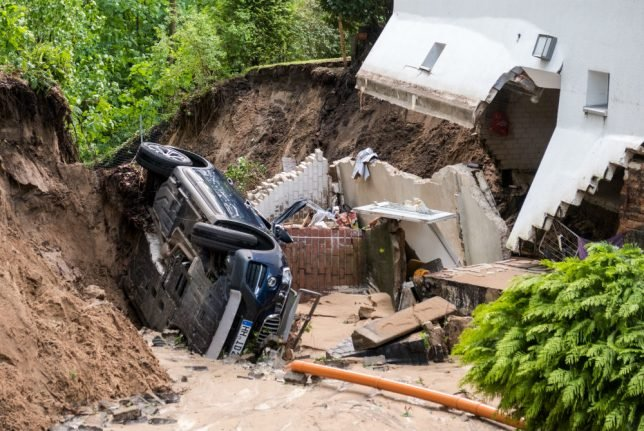 Damaged homes and flooded streets after thunderstorms sweep across Germany