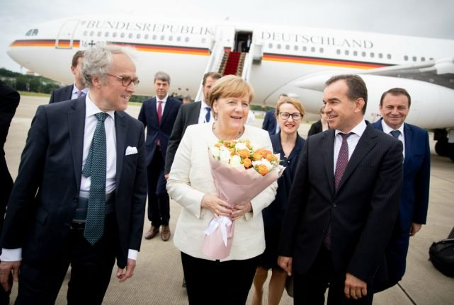 Merkel arrives in Russia for talks with Putin about Iran, Ukraine and energy