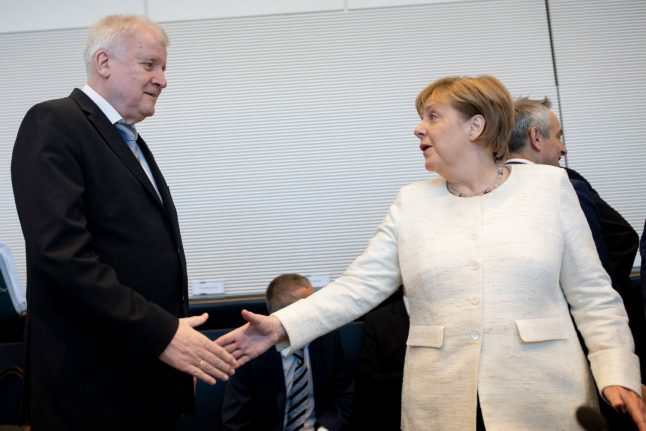 Coalition crisis over? Merkel and Seehofer reach late night deal on migrants