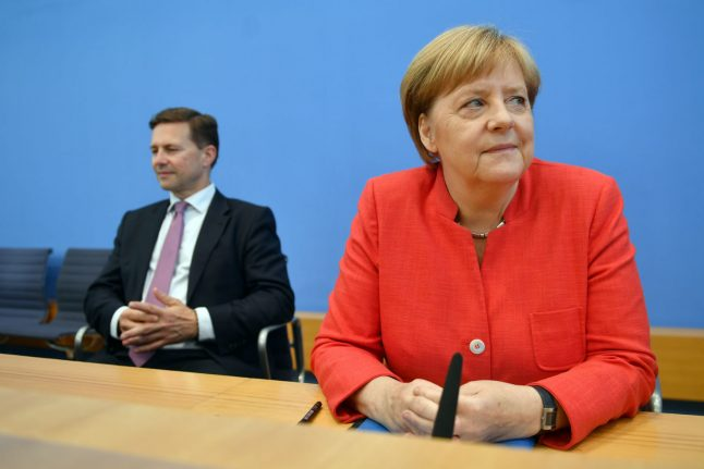 Merkel 'outraged' by Nazi chants in far-right rally